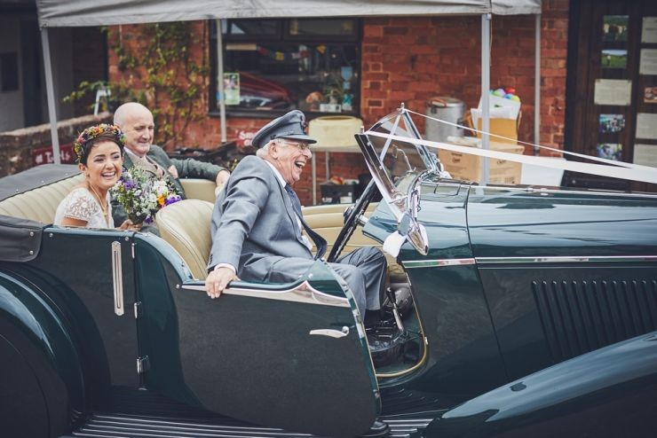 West Town Farm barn wedding photography of bride and father in vintage wedding car