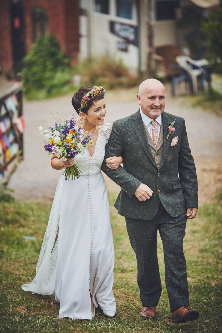 Bride and father walking to ceremony at a wedding at West Town Farm in Exeter