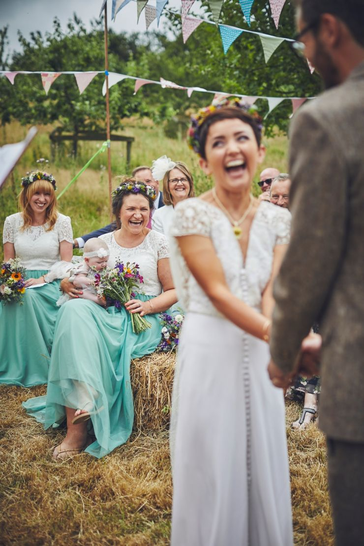 wedding photography of bride laughing during ceremony at West Town Farm in Devon