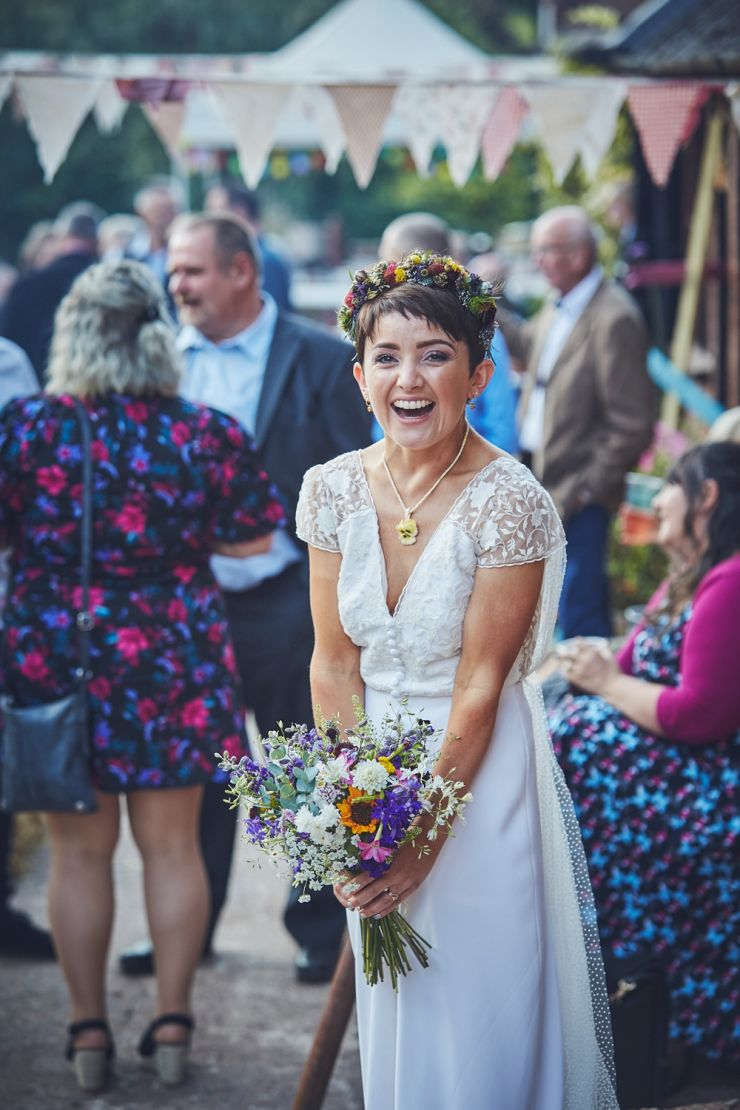 fun wedding photography of bride laughing at Devon wedding